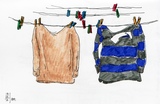 two shirts hanged in a clothes line sketch made with pen and markers